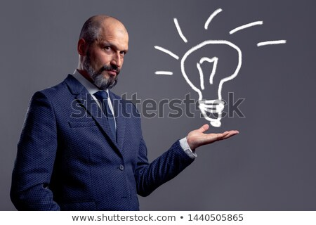 young blue collar holding bulb Stock photo © photography33