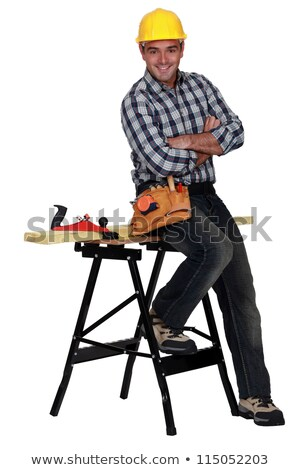 Relaxed carpenter next to a workbench Stock photo © photography33