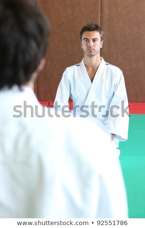 Two men kneeling on a judo mat Stock photo © photography33