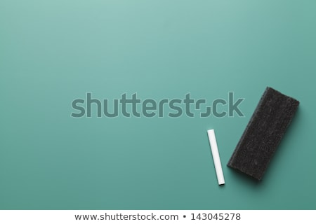Colorful chalk and eraser on a blank smudged blackboard Stock photo © bbbar