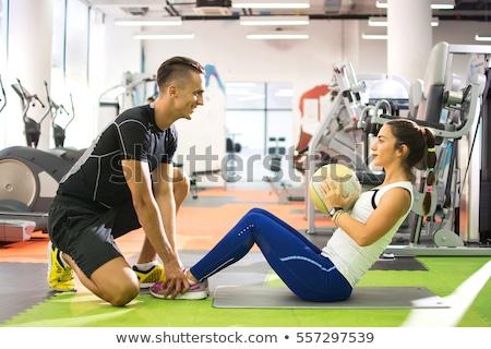 Férfi fitnessz edző tart labda izolált Stock fotó © stockyimages