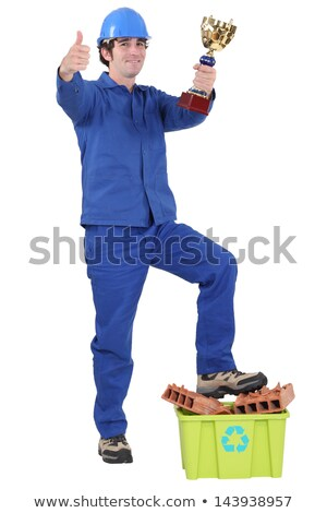 Builder stood with trophy and box of recyclable materials Stock photo © photography33