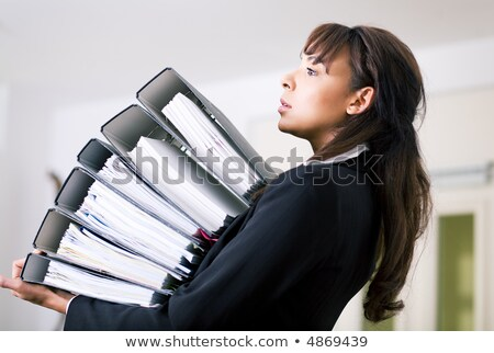 Female secretary carrying office files Stock photo © stockyimages