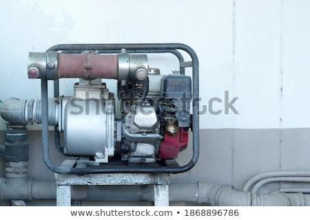 Electrician Repairing Sprinkler Pump Stock photo © lisafx