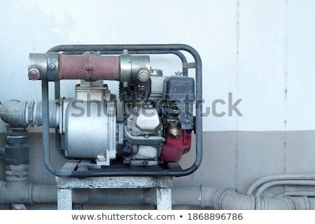 электрик · разбрызгиватель · насос · см. - Сток-фото © lisafx