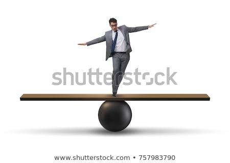 man balancing stock photo © pancaketom
