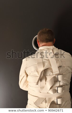 waiting in a straitjacket stock photo © sumners