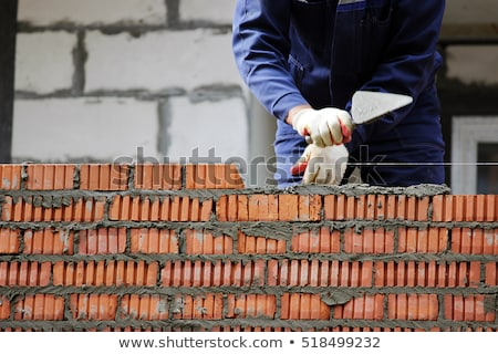 Bricklayer building a house Stock photo © photography33