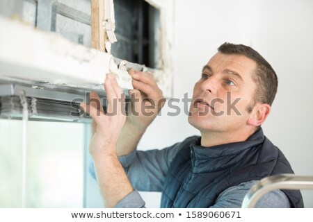 Carpenter with a stepladder and wooden shutter Stock photo © photography33