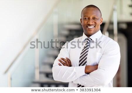 Gelukkig zakenman gevouwen armen glimlachend camera Stockfoto © wavebreak_media