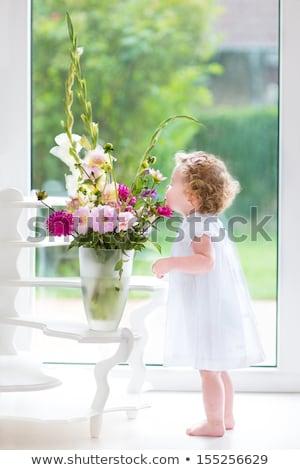 pretty girl smelling a sweet Stock photo © carlodapino