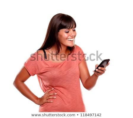 jonge · vrouwelijke · mobieltje · witte · gezicht - stockfoto © wavebreak_media