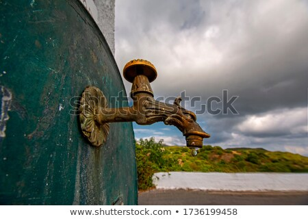 屋外 給水栓 青 曇った 空 水 ストックフォト © morrbyte