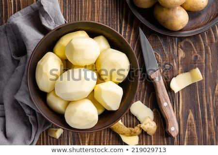 hámozott · krumpli · otthon · asztal · tányér · bőr - stock fotó © ruslanomega