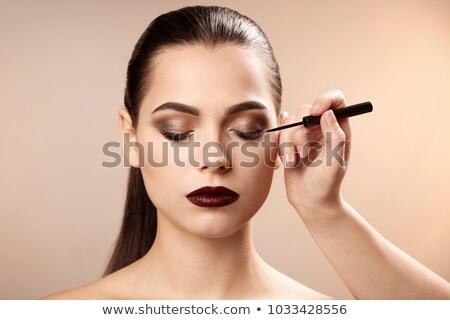 makeup artist applying eyeliner to woman Stock photo © wavebreak_media