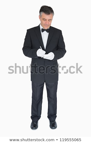 Waiter taking order in his notepad on white background Stock photo © wavebreak_media