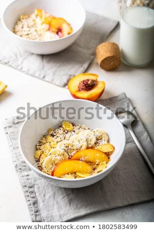 Kom ontbijtgranen vruchten lepel zemelen Stockfoto © ElinaManninen