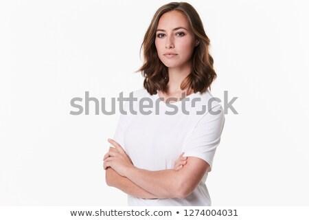 Ernstig brunette vrouw armen gevouwen witte Stockfoto © wavebreak_media