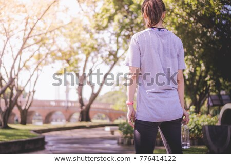 back of woman with bottle Stock photo © ssuaphoto