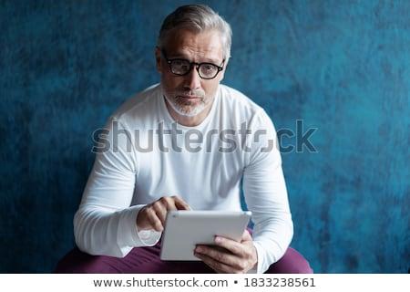 mature businessman holding digital tablet stock photo © andreypopov