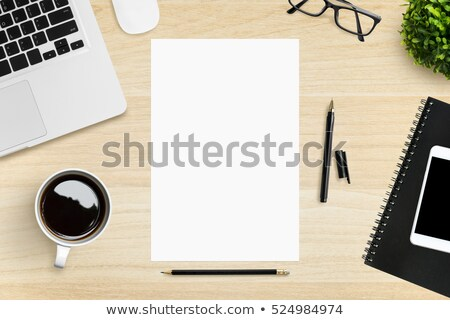Wireless phone and blank paper on tabletop Stock photo © stevanovicigor