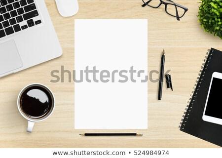 Wireless phone and blank paper on tabletop Stock photo © stevanovicigor