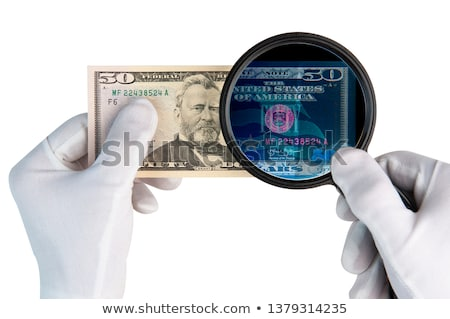 hand magnifier over banknote isolated on white background Stock photo © natika