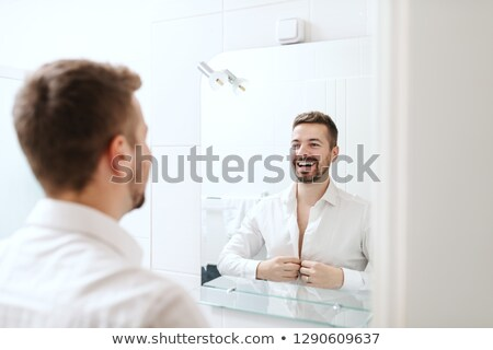 Handsome young man dressing up Stock photo © Nejron