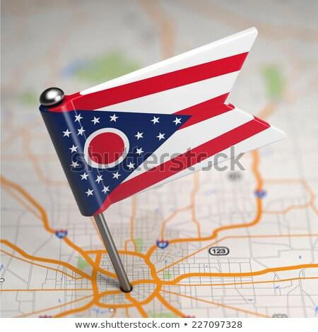 Ohio Small Flag on a Map Background. Stock photo © tashatuvango