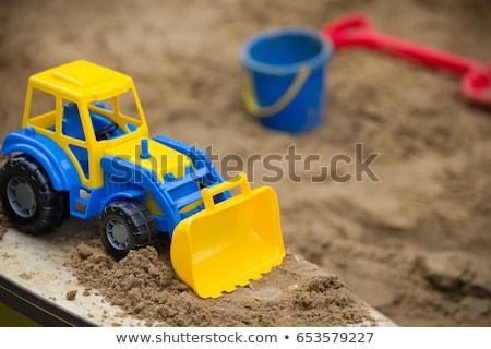 Toys in a sandbox closeup Stock photo © olandsfokus