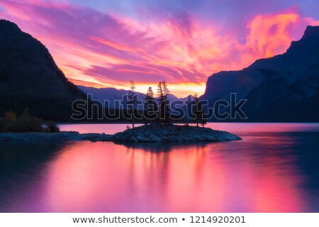 Orange Mountain Reflection in Lake Minnewanka Stock photo © jameswheeler