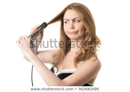 funny portrait of a young female hairstylist holding her tools stock photo © lightpoet