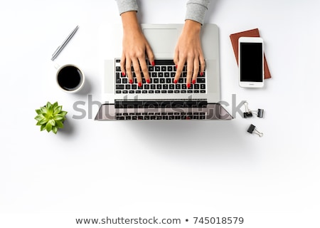 Office table with laptop and female hands Stock photo © tannjuska