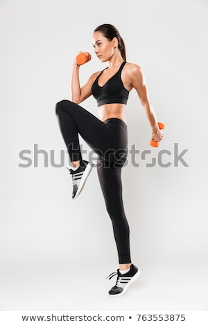 Beautiful athletic woman with dumbbells doing sport exercise, is Stock photo © vlad_star