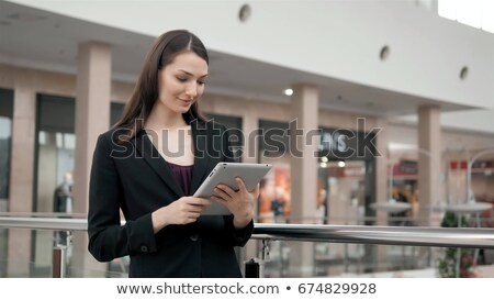 Woman working with tablet PC in airport terminal Stock photo © d13