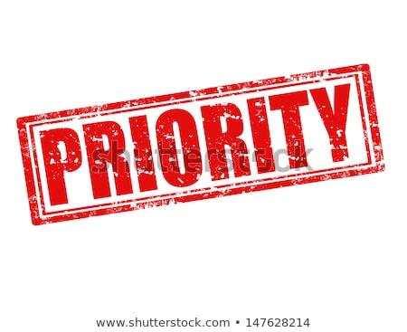 Priorytet pieczęć biały biuro tle niebieski Zdjęcia stock © fuzzbones0