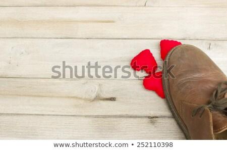 Сток-фото: Female Leg Treading Paper Heart