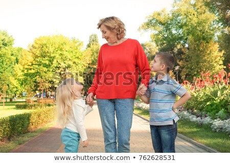 mature woman with little girl on hands outdoor stock photo © paha_l