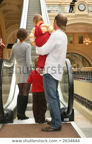 behind family of four in shop and escalator Stock photo © Paha_L