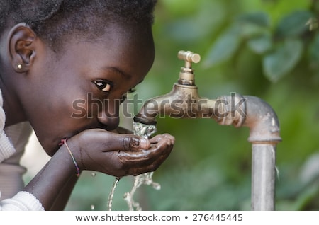african child with water stock photo © adrenalina