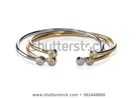 Zdjęcia stock: Set Of Three Colored Gold And Diamond Bracelets Stacked