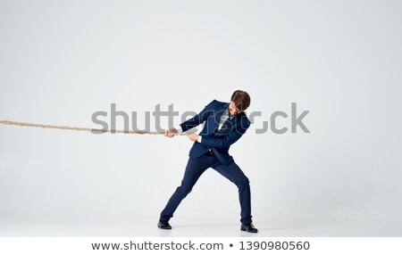 businessman tied up with a rope isolated over white background stock photo © zurijeta