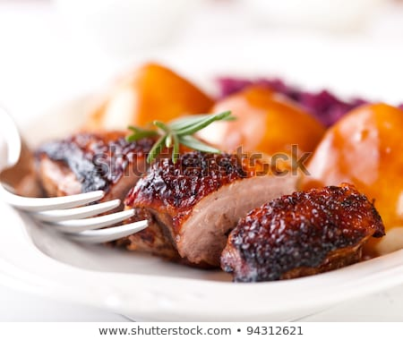 Stock photo: Roast duck with potato dumplings and white cabbage