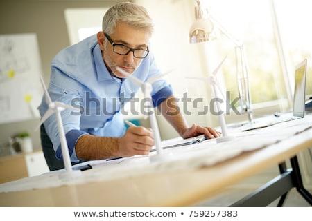 Man working with model wind turbines on the table. Stock photo © RAStudio