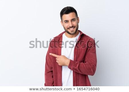 молодым · человеком · указывая · право · Постоянный · белый · улыбаясь - Сток-фото © nyul