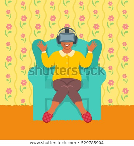 Old african woman wearing virtual reality glasses at home Stock photo © vectorikart