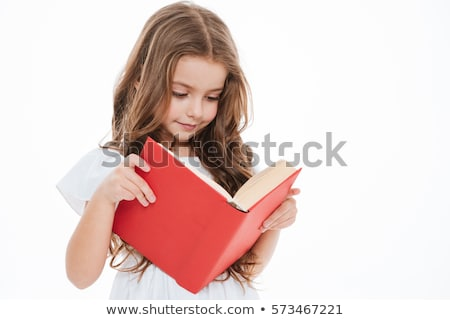 Charming little girl standing and holding red book Stock photo © deandrobot