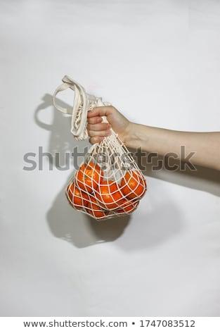 Basket of mandarins in the hands of a man Stock photo © Yatsenko