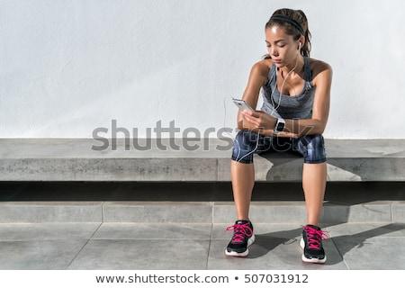 Nő atléta fülhallgató okos óra nyár Stock fotó © deandrobot
