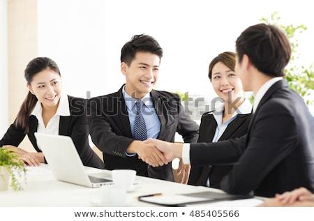 young asian happy businessman gesturing stock photo © rastudio